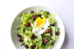 This crispy speck salad is simple to make and deliciously rich thanks to poached eggs and crispy bacon.