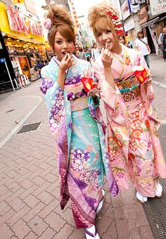 Kimono Nagoya — Two girls in modern pastel furisode in what might...
