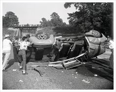 """Accident #196, August, 1953  Described on envelope, """"Negro accident at underpass on highway 59 north of Cleveland 11 miles. International station wagon.""""  The Cleveland Studio, large format negative."""