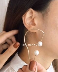 This gorgeous piece slips on easily and stays on snugly 💛 Shop the Krys Pearl Ear Cuff at thehexad. Ear Jewelry, Jewelery, Double Ear Piercings, Silver Engagement Rings, Ring Engagement, Dainty Earrings, Dangle Earrings, Custom Jewelry, Pearls