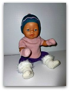 Free doll knitting pattern shown on Baby born.