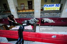 03-13 A student cleans the ground as opposition activists sleep... #berehove: 03-13 A student cleans the ground as opposition… #berehove