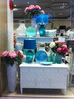 White Moroccan furniture - Buffet, and console and bedside tables. Comes in black and turquoise also. Peony Roses and turquoise glass lamps. Metal decorative bowls