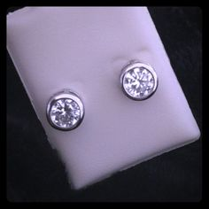 NWOT Sterling Silver Cubic Zirconia Studs Dazzling cubic zirconia studs enclosed in sterling silver. Posts are marked 925. These are NWOT. Beautiful earrings. Jewelry Earrings