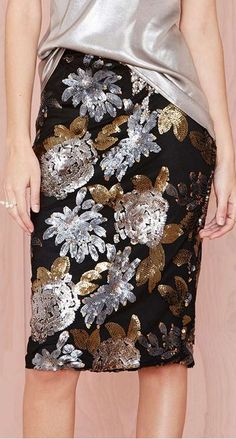 A lovely black sequin pencil skirt showered with bronze, silver & pewter flowers.