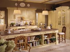 Love the bookcase on the back of this island.  Would be great for a kitchen that is open to another room.
