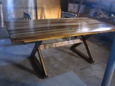 DIY dining room table.  i love this table...one of the favorites i've seen and it was done with trim from their house. looks even better in the room and out of the garage!