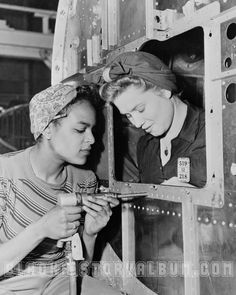 Young African American women employed by the Douglas Aircraft Company in Long Beach, California, 1938. Two of thousands of African Americans who moved to California and through the West Coast during World War II to find work in arms and munitions plants ~