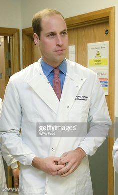 Prince William Duke of Cambridge wears a lab coat during a visit to the Royal Marsden NHS Foundation Trust hospital in Sutton on November 18 2015 in...