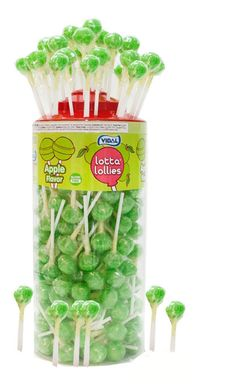 Creating a lollipop tree for your St. Patrick's Day party is easy! Just buy a tree-shaped piece of Styrofoam and stick these Lotta Lollies green apple lollipops into the Styrofoam. #candybuffet
