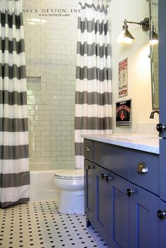 soap dish....bathrooms - charcoal gray painted extra-wide single bathroom vanity cabinet marble countertop oil-rubbed bronze faucet kit vintage tiles floor twin white gray striped shower curtains subway tiles shower surround vintage sconces flanking rectangular pivot mirror