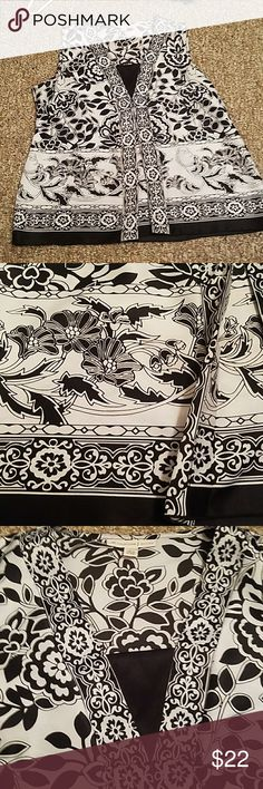 Black and white sleeveless blouse Very cute for a day at work. Asian inspired pattern.  Figure flattering pleats a long the stomach area. 14 petite. Great condition JM Collections Tops Blouses