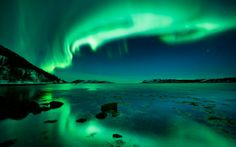 The Aurora borealis, or Northern Lights, turn the sky green at Ottery, Nord-Trndelag, Norway.