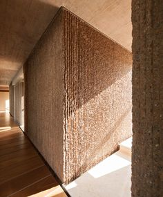 Slabs of corduroy-textured concrete encase a Spanish home by Muka Arquitectura