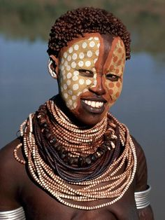 Karo Woman, Ethiopia  Photograph by Carol Beckwith and Angela Fisher    Relying on nature and trade for what they need, the Karo decorate their bodies to enhance their looks and attract the opposite sex. Here, a woman named Kawo wears face paint that imitates a guinea fowl's spotted plumage.