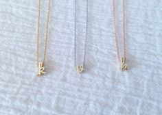 Dainty Lowercase Gold Initial Necklace w Gold, Silver, Rose Gold Chain, Dainty Cursive Initial Necklace, Holiday Gift, Bridesmaid Gift by MignonandMignon on Etsy https://www.etsy.com/listing/210224460/dainty-lowercase-gold-initial-necklace-w