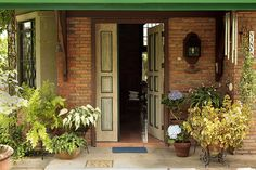 This charming�Filipino-Style�cottage is owned by Vinya Alcantara, the mother of Boots Alcantara, the proprietor of Casa San Pablo. The front door of the two-storey house is marked with blooming hydrangea and other house plants.