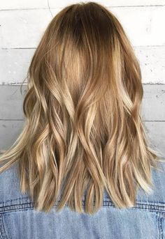 Love this hair color for Fall – a darker blonde with honey and copper hues. Color by Ashley Ray.