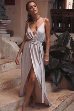 Make a statement in the Gisele Speck Maxi, made from a nude fabric with a bold silver fleck throughout. It is a floor length maxi and features a high split, deep V neckline, thin straps, low back and matching belt. Complete the look with silver accessories, nude strappy heels and messy high bun. By SABO FORMAL.