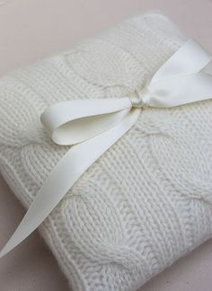 Use a cable-knit pillow for the rings | Brides.com