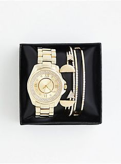"<div>Oh, you fancy, huh? This gift set seems to think so. The gold tone watch is embellished with a pavé face; the accompanying gold tone cuff bracelets (four in all) sport bedazzled arrows and half circle pendants. Two links can be removed on the watch for a tighter fit.</div><div><div><ul><li style=""list-style-position: inside !important; list-style-type: disc !important"">Set of 8</li><li style=""list-s..."