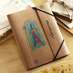 Store your travel memories and aspirations in a Watercolor Stamped Eiffel Tower Folio.
