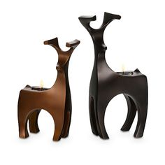 """Gleaming forest fellows stand at attention, antlers and all. Add a tealight to set their proud pose aglow. Pair includes one of each height/color: 8 1/2""""h, 10 1/2""""h. Bronze-finished resin.  Price:  $50.00/set of 2"""