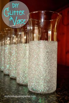 DIY Glitter Vase - perfect for a wedding or holiday decorating.  Uses dollar store vases!  Pinned over 100K times.