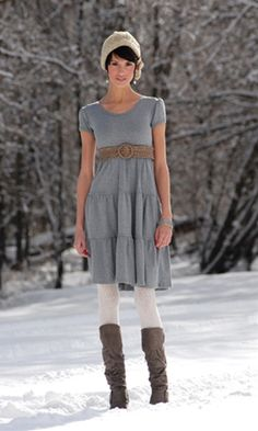 Love her dress, tights and hat....I'm so loving the dresses with tights and boots lately!