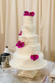These fuschia orchids make this cake too pretty to eat! Wedding Ceremony, Reception, Grand Hyatt, White Lilies, Atlanta Wedding, Cake Table, Flower Crown, Wedding Details, Floral Arrangements