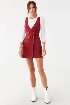 A faux suede pinafore mini dress featuring a plunging neckline, adjustable shoulder straps that cross at the back with concealed button fastenings, patch pockets, and double-breasted button closures. Girly Outfits, Skirt Outfits, Chic Outfits, Summer Outfits, Casual Dresses, Fashion Dresses, Suede Dresses, Woman Dresses, Pinafore Dress Outfit
