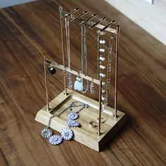 Keep your collection of necklaces and bracelets from tangling when you string them along this gleaming jewelry stand. A dish at the base hold smaller items with ease. Jewelry Chest, Jewelry Stand, Jewellery Storage, Jewelry Organization, Metal Necklaces, Jewelry Necklaces, Bracelets, Ballerina Jewelry Box, Hives And Honey