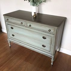 *** Sorry, This piece has SOLD*** We are always getting new pieces in, contact me for a custom order 😊 Beautiful newly refinished antique dresser chest. Professionally hand painted in smooth layers of duck egg blue, grays, and taupe. Metallic gold leaf here and there to make