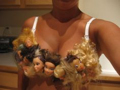 """Next up, in """"Things That Make You Go 'Ugh'"""" news: here's a bra decorated in Barbie doll heads. The unusual brassiere is made by artist Sarah Bellum of Etsy Barbie Doll Head, Lisa Phillips, Bras Best, Grunge, People Of Walmart, Incredible Gifts, Creepy Cute, Scary Scary, Halloween Disfraces"""