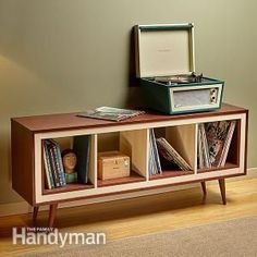 Ikea Kallax Hack: Mid-Century Modern Console  With this Ikea Kallax hack, mimic a mid-century modern classic by turning a simple shelving unit on its side, wrapping it with plywood inside and out, and attaching legs. Our materials cost was about $250. http://www.familyhandyman.com/woodworking/projects/ikea-kallax-hack-mid-century-modern-console/view-all:
