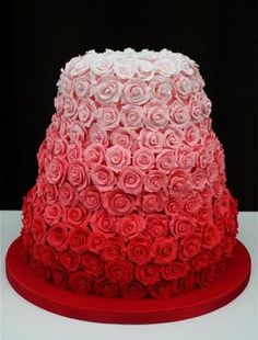 "'red rose ombre' | ""The Rose Wedding Cake"" - 'Covered in approximately 300 hand-pulled and hand coloured sugar roses,' by Janet Mohapi-Banks Sculptural Cake Design.  #cakes #weddingcakes #roses"