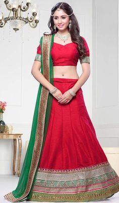 Step out in style in this red raw silk embroidered lehenga cholie. You will see some interesting patterns performed with lace and resham work. Upon request we can make round front/back neck and short 6 inches sleeves regular lehenga blouse also.#TraditionalShadesOfLehengaCholi