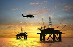 An offshore oil rig drilling platform. Global subsidies of fossil fuels rose to 1.9 trillion dollars in 2013. - Article