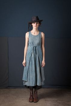 "This sleeveless 100% organic cotton jersey dress wraps around the body and ties in the front. Measures 46"" from shoulder. Available in Natural Blue Grey. Size Large. Wash gently + Hang to dry. Only one available. All sales final."