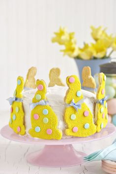 Transform a store-bought frosted cake into a colorful grand finale with sugar cookies and royal icing.  Instructions: Bunny Cake