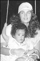 Baby Junior Gong Damian Marley w/ mum Cindy Breakspeare
