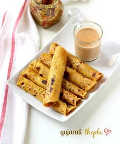 Gujarati Thepla - A traditional whole wheat flour flat-bread breakfast dish served with a cup of tea.