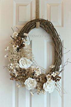 Timewashed wreath. Love the burlap flowers !