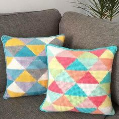 Add a punch of colour to your home with this bright and bold Tunisian crochet cushion in pop colors and a fun triangle pattern - find the pattern on LoveCrochet!