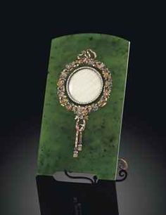 A FABERGE JEWELLED SILVER-GILT AND FOUR-COLOUR GOLD-MOUNTED NEPHRITE PHOTOGRAPH FRAME