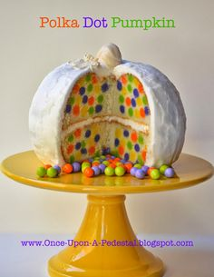 um... how did she DO that?  I mean... shouldn't those little balls sink? how are they suspended?  hmm... Once Upon A Pedestal: Surprise Inside Cake - Hidden Mini Polka Dots in Pumpkin!