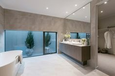 Master Ensuite Walk in Robe: (Classic Hamptons) Marbella - Porter Davis. Extend the view with large windows.