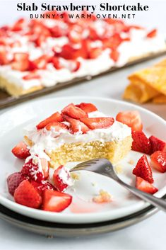 Slab Strawberry Shortcake- a moist, delicious and tender slab cake recipe smothered in homemade whipped cream and fresh sliced strawberries.   #strawberry #strawberrycake  #strawberryrecipes #strawberryshortcake