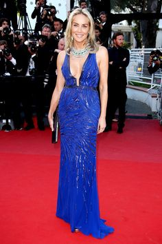 plunging Roberto Cavalli gown in cobalt+++ emerald necklace and earrings