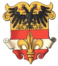 The Estate and city of Triest (now Trieste, Italy) joined Austria in 1382 as a protection against Venice. The arms were officially granted in 1467 by Emperor Friedrich III after the siege by the Venetians. The arms show in the lower half a spear, symbol of St. Sergius, patron saint of the city on the arms of Austria. The present city uses only the spear in its arms, but in a red field. The upper half shows the Imperial eagle